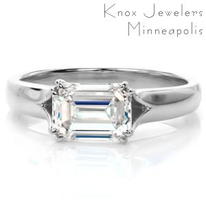 Custom solitaire engagement ring in Las Vegas with a twisted asymmetrical band holding a round brilliant center stone.