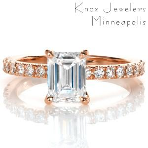 Gorgeous micro pave rose gold engagement ring in Atlanta. The emerald cut center stone lends a vintage appeal to this classic diamond and rose gold engagement ring design.