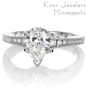 Pear cut diamond engagement ring in Raleigh with hand engraving and filigree.