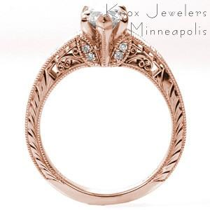 Rose gold custom engagement ring in San Francisco with a unique pear cut center diamond held on a band featuring bead set diamonds and hand engraving.