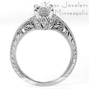 Vintage inspired custom engagement ring in Nashville with a unique pear cut center diamond held on a band featuring bead set diamonds and hand engraving.