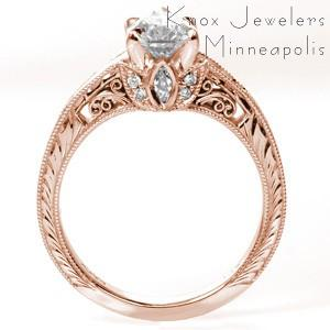 Rose gold custom engagement ring in Montreal with a unique pear cut center diamond held on a band featuring bead set diamonds and hand engraving.