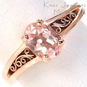 Dayton rose gold engagement ring with filigree and oval morganite center stone.
