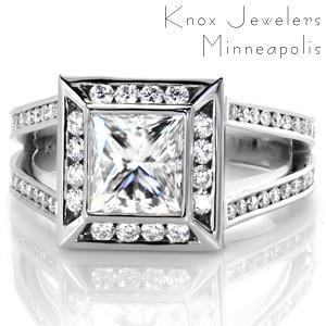 Design 3378 is a beautiful contemporary engagement ring setting. Featuring a 1.50 carat princess cut center diamond in a bezel setting, the ring has a halo and a split shank band. The diamonds on the halo and band are in channel settings which compliment the bezel of the center stone.