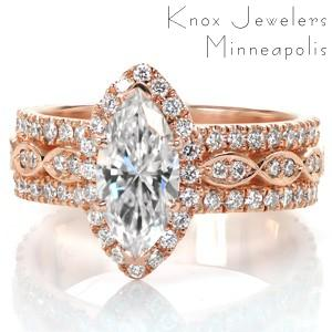 Rose gold wide band engagement ring in Cleveland with marquise halo and center stone.