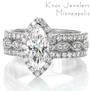 Stamford custom created halo engagement ring with a marquise shaped center diamond atop a wide three row diamond band.