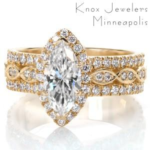 Columbia custom created halo engagement ring with a marquise shaped center diamond atop a wide three row diamond band.