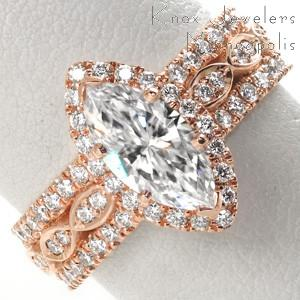 Rose gold engagement ring in Colorado Springs with marquise center stone, diamond halo and micro pave diamond band.
