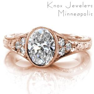 Des Moines rose gold custom engagement ring with a bezel set oval center diamond and a hand engraved band.