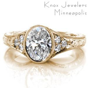 Fargo antique inspired custom engagement  ring with a bezel set oval center diamond and a hand engraved band.
