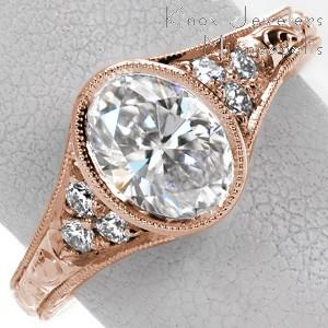 Antique engagement ring in Jacksonville with oval center stone, hand engraving and full milgrain bezel.