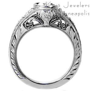 Montreal antique inspired custom engagement  ring with a bezel set oval center diamond and a hand engraved band.