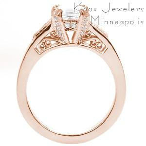 Rose gold custom engagement ring in Pittsburgh with an asscher cut center diamond held by diamond set prongs and profile filigree curls.