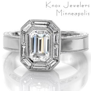 Antique inspiration meets geometric design! Baguette side stones mirror the shape of the emerald cut center stone in a stunning octagon halo. The edges of the setting are detailed with milgrain texture. Hand wrought filigree and half wheat engraving adorn the sides of the band for a stunning profile.