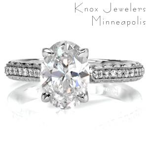 Our Pompeii engagement ring setting is redefined with the addition of a 1.50 carat oval cut center diamond. Micro pavé diamonds line the band, bordered by milgrain edging and hand engraving in a wheat style. A surprise marquise shaped diamond adds the finishing touch to this vintage inspired design.