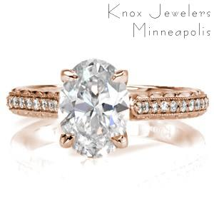 Rose gold custom engagement ring in Winnipeg with a hand engraved band, marquise surprise stone and oval center diamond.