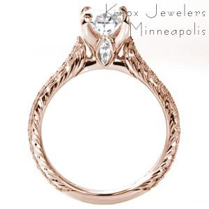 Rose gold custom engagement ring in Knoxville with a hand engraved band, marquise surprise stone and oval center diamond.