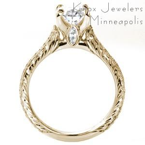 Vintage inspired custom engagement ring in Oakland with a hand engraved band, marquise surprise stone and oval center diamond.