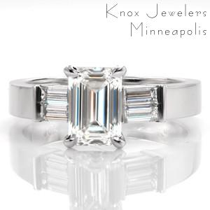 Design 3389 is elegantly detailed with a pair of baguette cut diamonds on each side of the center stone. The step-cut facets of the emerald cut is mirrored in the surrounding baguettes. The lustrous 14k white gold is the perfect transition from the shine of the smooth metal to brilliant diamonds.