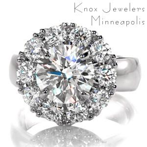 Design 3390 is a magnificent custom engagement ring displaying a dazzling 1.50 carat round brilliant center diamond surrounded by a halo of another ten prong set round diamonds. A wide, rounded, high polished band adds a contemporary feel to this halo design.