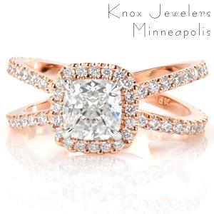 Rose gold custom engagement ring with a split diamond band with a halo surrounding a cushion cut center in Des Moines.