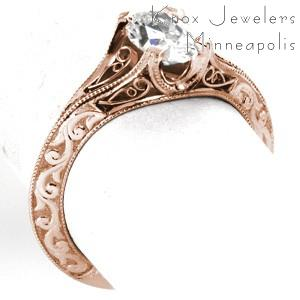 Unique rose gold engagement ring in Virginia Beach features hand formed filigree curls and hand carved relief style engraving. This antique rose gold engagement ring style has a unique knife edge band.