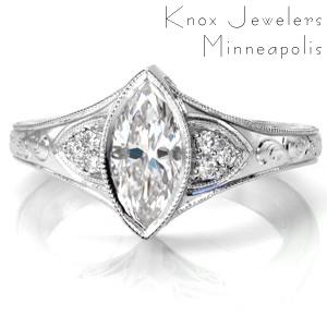 Antique inspired custom engagement ring in Akron with a unique marquise center diamond set in a bezel setting.