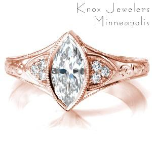 Antique inspired custom engagement ring with a unique marquise center diamond framed by bead set diamonds and hand engraving.