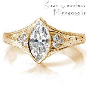 Antique inspired custom engagement ring with a unique marquise center diamond framed by bead set diamonds and hand engraving in Grand Rapids.