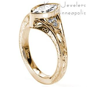 Stunning antique engagement ring styles in San Antonio. This yellow gold vintage engagement ring style features hand engraving, hand formed filigree curls, and micro pave diamonds. The bezel set marquise center diamond adds to the elegant flow of the flared band.