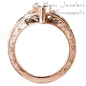 Rose gold custom engagement ring in Baltimore with a unique marquise center diamond set in a bezel setting.