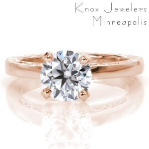 Knoxville vintage inspired custom rose gold engagement ring with a round center diamond and unique hand engraving and filigree curls.