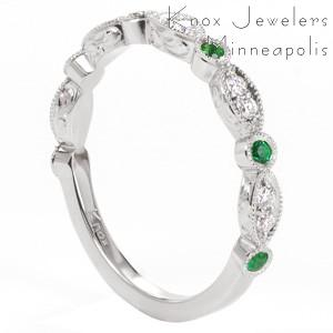 Custom scalloped wedding band with emeralds and diamonds. This stunning look can also be made with any color for a sapphire wedding band in Austin. Hand engraved details complete the look of this unique design.