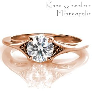 Rose gold custom engagement ring in Sacramento with a round brilliant diamond center and hand formed filigree.