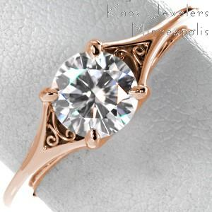 Rose gold engagement ring in Colorado Springs with round brilliant center stone and hand-formed filigree.