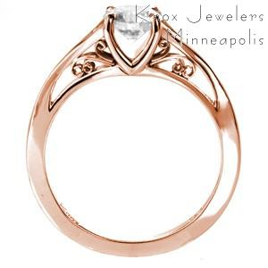 Rose gold custom engagement ring in Tucson with a round brilliant diamond center and hand formed filigree.