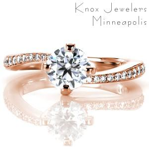 Rose gold custom engagement ring with a contemporary round cut center diamond and asymmetrical band in Montreal.