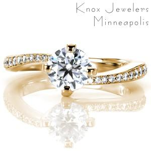 Custom engagement ring in Buffalo with round brilliant center stone in a bypass setting.