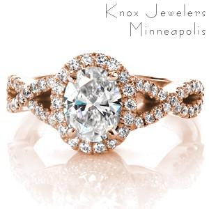 Custom rose gold oval diamond engagement ring in Albuquerque with a unique overlapping band and mirco pave diamond halo.