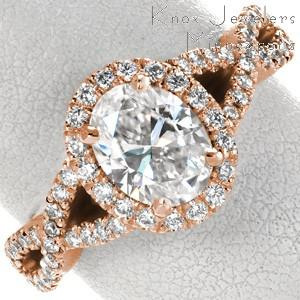 Custom engagement ring with oval center stone, diamond halo and woven band in Jacksonville.