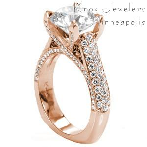 Rose gold engagement ring in Fargo with micro pave diamonds, round center stone and hand formed filigree.