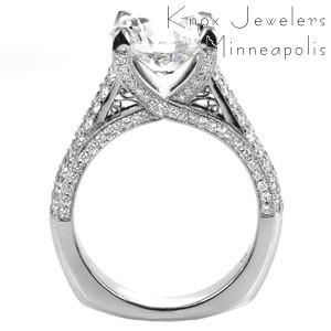 White gold engagement ring in Fresno with round brilliant center stone held in a diamond trellis design with milgrain texture.