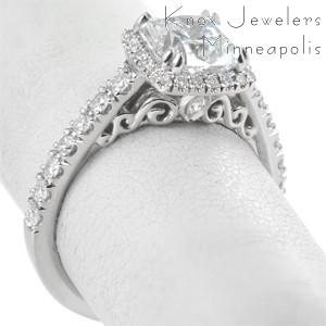 Custom engagement ring with cushion center stone, filigree and diamond halo in Ottawa.