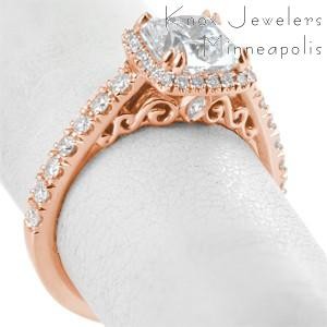 Halo rose gold engagement rings in Chicago. The beautiful halo and band are created using micro pave diamond setting styles. The basket under the halo is intricately detailed with filigree and small marquise surprise diamonds.
