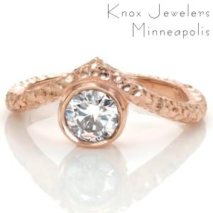 Unique, one of a kind rose gold engagement rings in Atlanta. Create your own perfect custom design, such as this bezel set rose gold stacker ring. This unique engagement ring features a hammered finish with an angled band around a round bezel set center diamond.