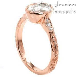 A scalloped band with antique details sets this custom rose gold engagement ring in Atlanta. The rose gold band is detailed with diamonds and relief style hand engraving.