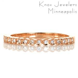 Cute rose gold stacking ring in Salt Lake City is the perfect addition to a set of stackers! This stackable rose gold ring design is made of individually bezel set round diamonds, with milgrain detailing the bezels.