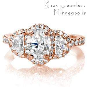 Oakland rose gold engagement ring with oval center stone, half moon side stones and diamond band.