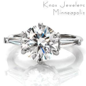Design 3447 is a contemporary twist on a vintage classic. This three stone diamond engagement ring design features a long, elegant, tapered baguette on each side with a large center stone. The 2.50 carat round brilliant diamond center is held in a six prong setting for a nod to the original antique inspiration.