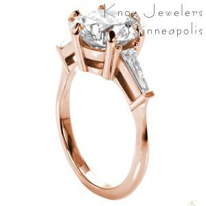 Custom rose gold contemporary engagement ring in McAllen with a round center stone and tapering baquette side diamonds.